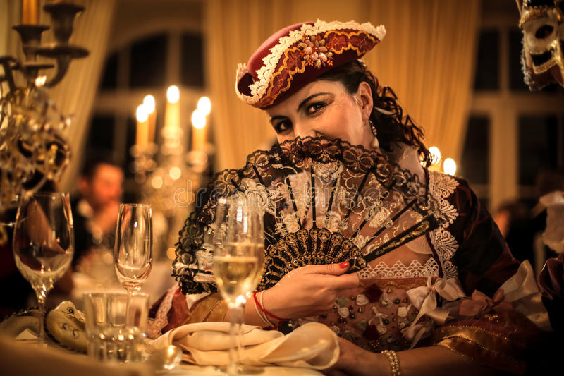 Woman with fan at a party royalty free stock images