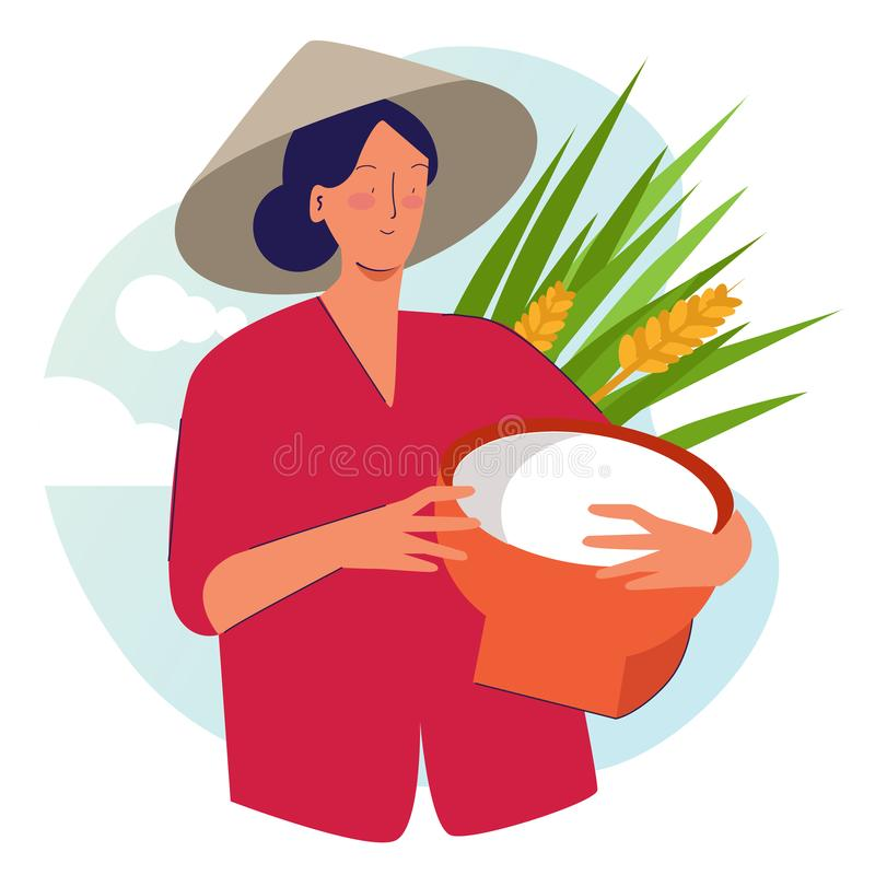 Woman farmer holding basket wearing cap in rice padi field harvesting. Traditional farming organic nature stock images