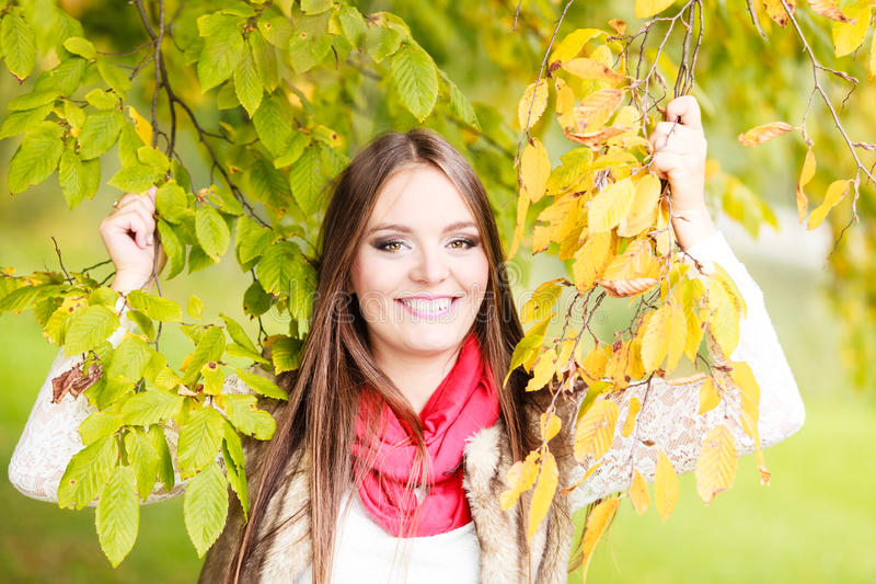 Woman fashion girl relaxing walking in autumnal park. Fall lifestyle concept, harmony freedom. Attractive young woman fashion girl long hair relaxing walking in royalty free stock photos