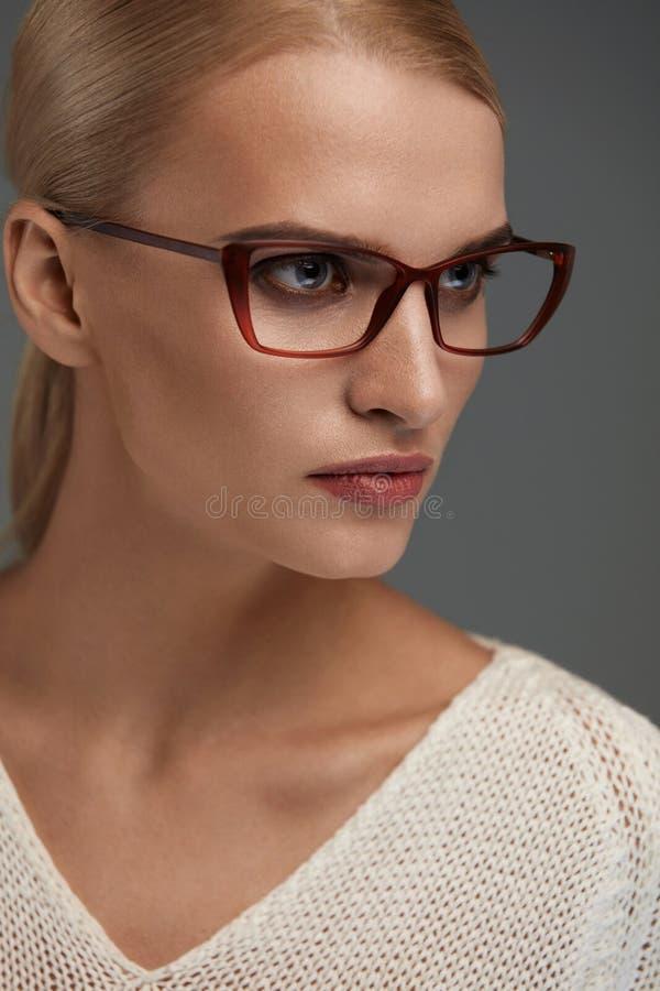 Woman In Fashion Glasses. Beautiful Female In Stylish Eyeglasses stock photos
