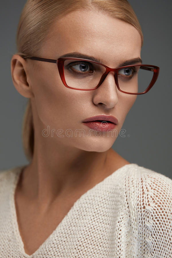 Woman In Fashion Glasses. Beautiful Female In Stylish Eyeglasses. Woman In Fashion Eye Glasses. Beautiful Young Female With Natural Face Makeup In Stylish royalty free stock photography