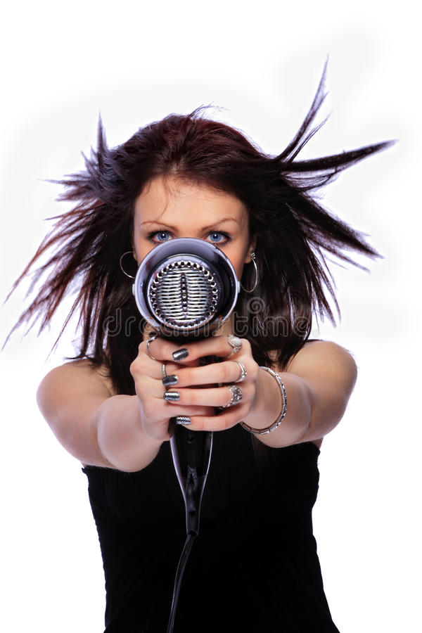 Woman with fashion hairstyle holding hairdryer stock images