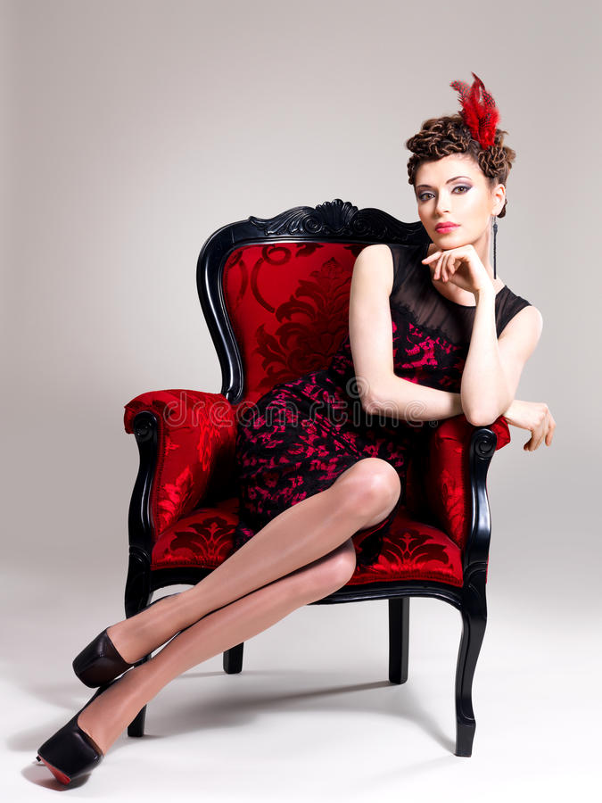 Download Woman With Fashion Hairstyle And Red Armchair Stock Image - Image: 30627389