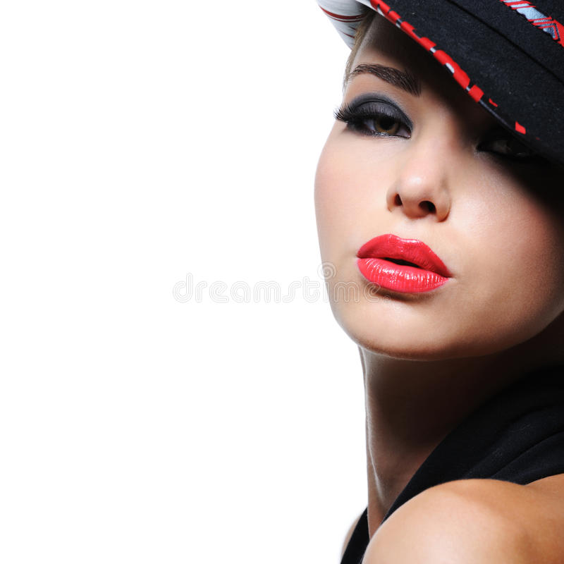 Woman in the fashion hat with bright red lips stock photos