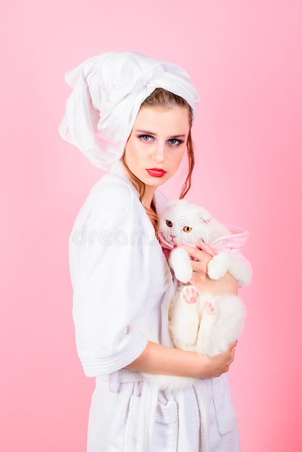 Woman with fashion makeup hold white cat. Beauty salon and hairdresser. Makeup cosmetics and skincare. Fashion jewelry. And accessory. Fashion portrait of woman stock image