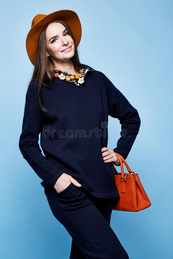 Woman fashion model glamour pose wool cashmere clothing suit pan. Ts sweater dark blue color accessory had bag jewelry necklace sport wear casual style for walk stock image