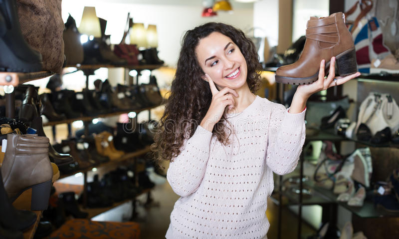 Woman at fashion shoe store stock images