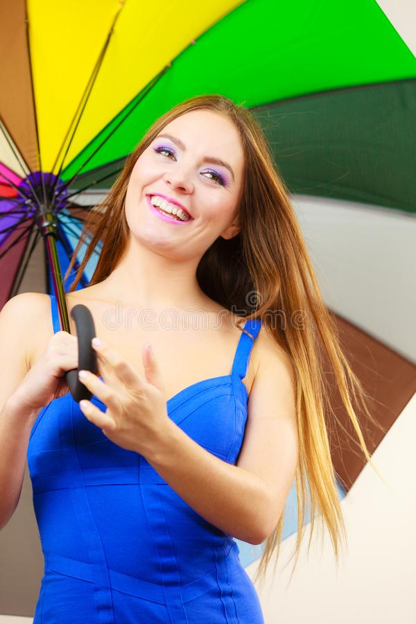 Woman in summer dress holds colorful umbrella stock photos