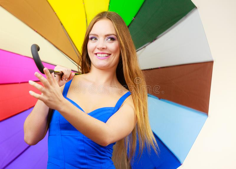 Woman in summer dress holds colorful umbrella stock image