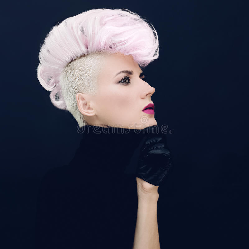 Woman with fashionable hairstyle Colored hair trend. Sensual woman with fashionable hairstyle Colored hair trend royalty free stock photo