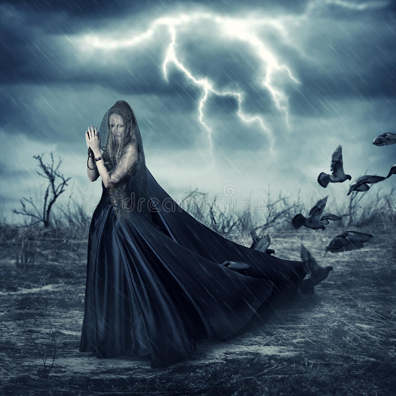 Woman in fashionable medieval dress and pigeon birds royalty free stock photography