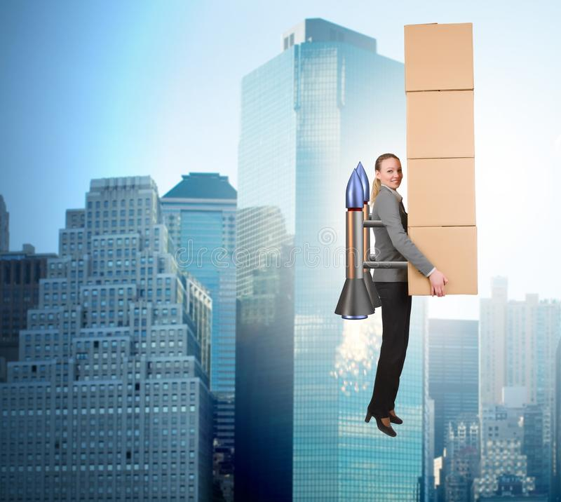Woman in fast box delivery service on rocket stock photo