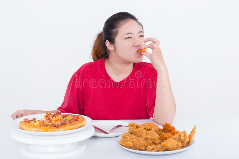 Woman with fast food. High calories food concept royalty free stock images