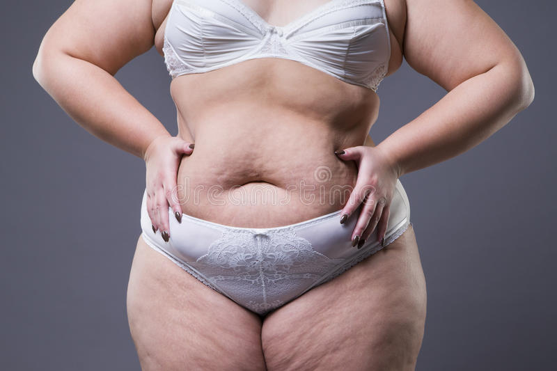Woman with fat abdomen, overweight female stomach stock photos
