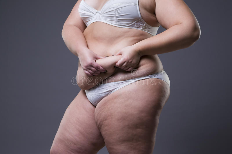 Woman with fat abdomen, overweight female stomach royalty free stock image