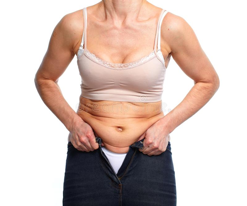 Woman with fat belly. stock photos