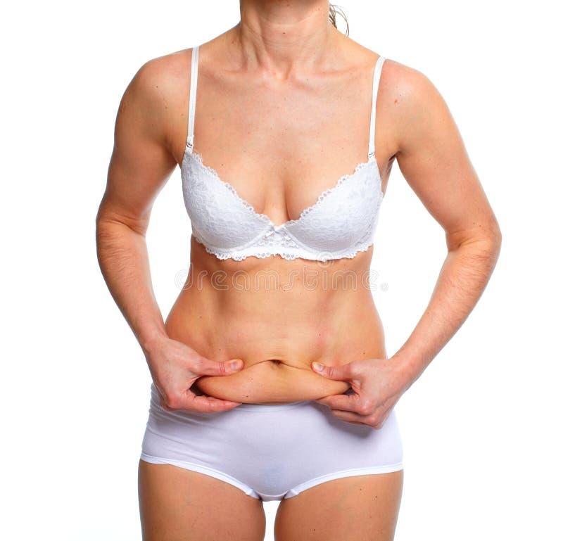 Woman fat belly. stock photos