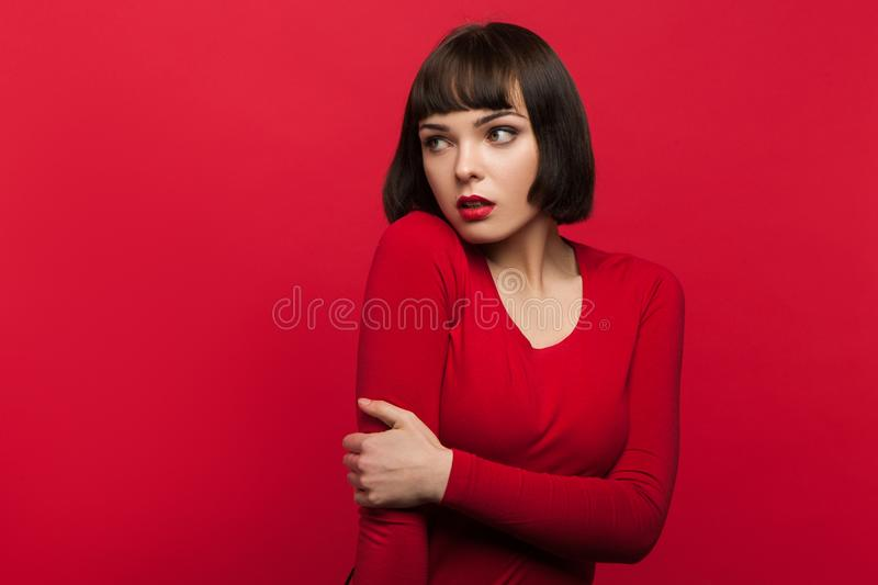 Woman in fear. Afraid young female royalty free stock photography
