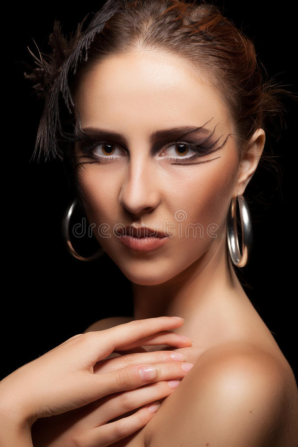 Woman with feather in head on black background. Art fashion goth style. Beauty. Perffect skin royalty free stock photo