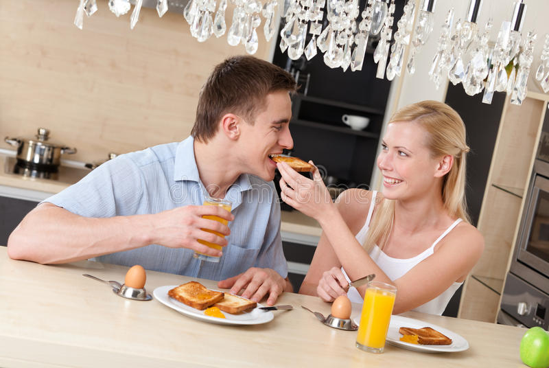 Download Woman Feeds His Husband With Breakfast In The Kitchen Stock Photo - Image of gladness, cheerful: 28493864