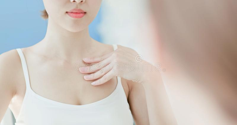 Woman scratching her chest royalty free stock photography