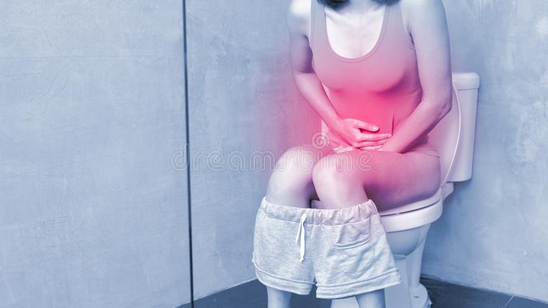Woman feel pain with constipation. In wc royalty free stock image