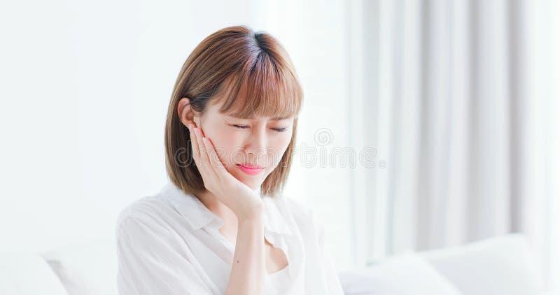 Woman feel pain on teeth stock photos
