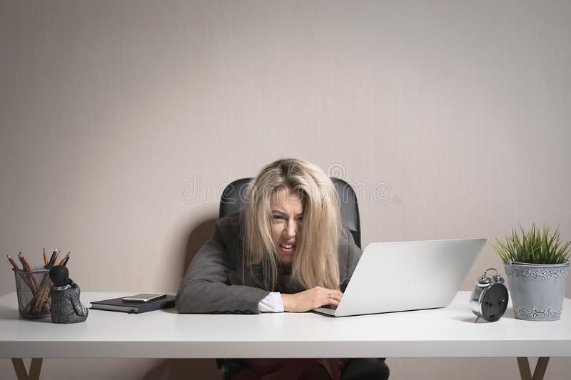 Woman feeling exhausted at work stock photos