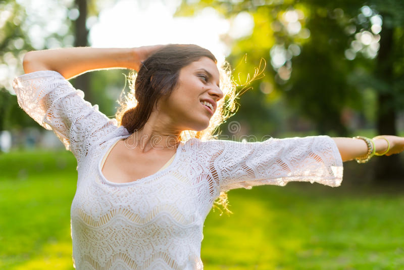 Woman feeling freedom at sunset stock photography