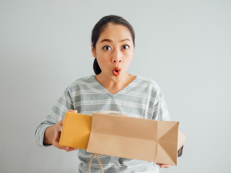 Woman is feeling happy and surprised with the online purchursed. Asian woman is feeling happy and surprised with the online purchursed product and survice royalty free stock photo