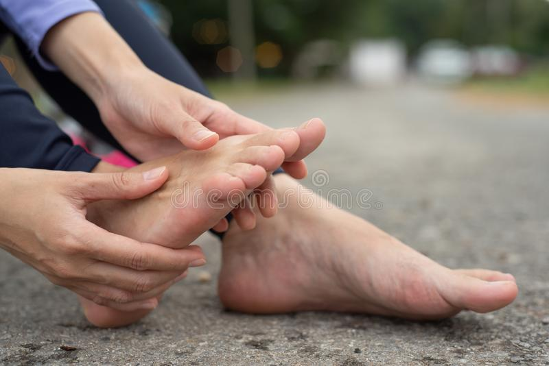 Woman feeling pain in her foot royalty free stock image