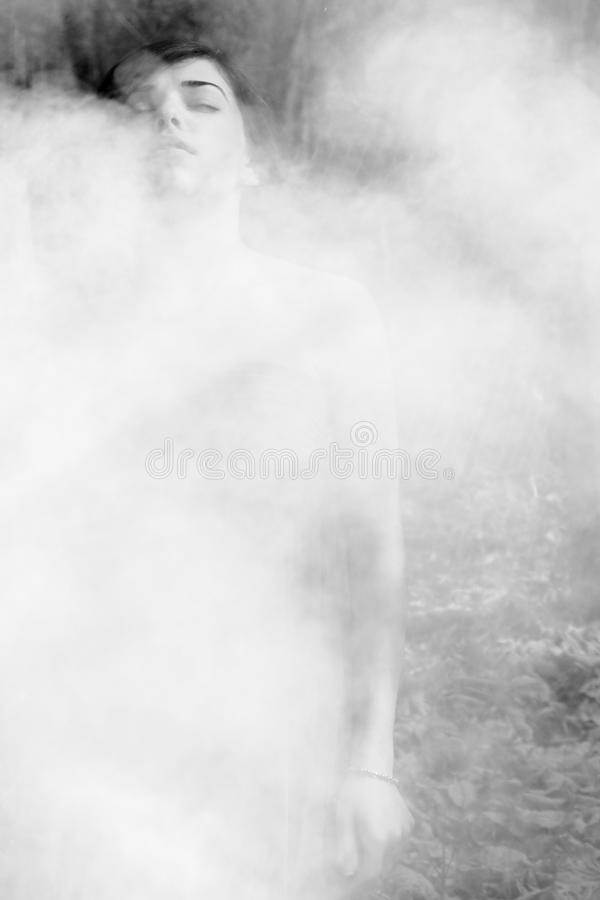 Woman feeling smoke royalty free stock photo
