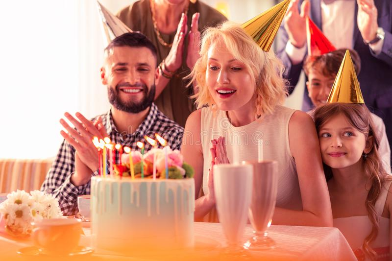 Woman feeling truly happy celebrating birthday with family stock photography