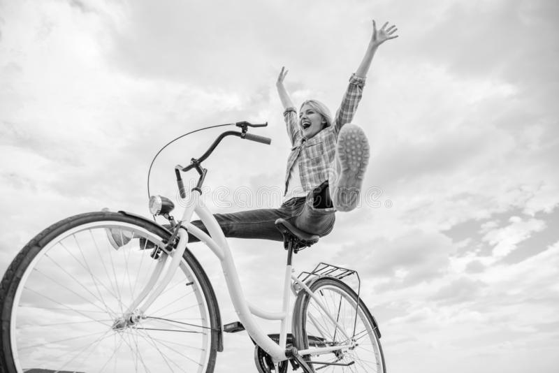 Woman feels happy while enjoy cycling. Girl rides bicycle sky background. How cycling changes your life and make you royalty free stock images