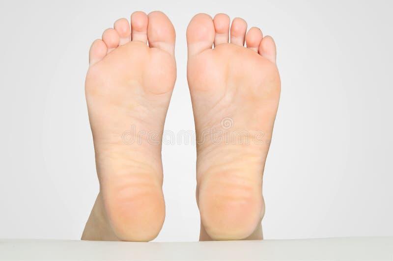 Woman feet. Beautiful woman feet on bed stock photo