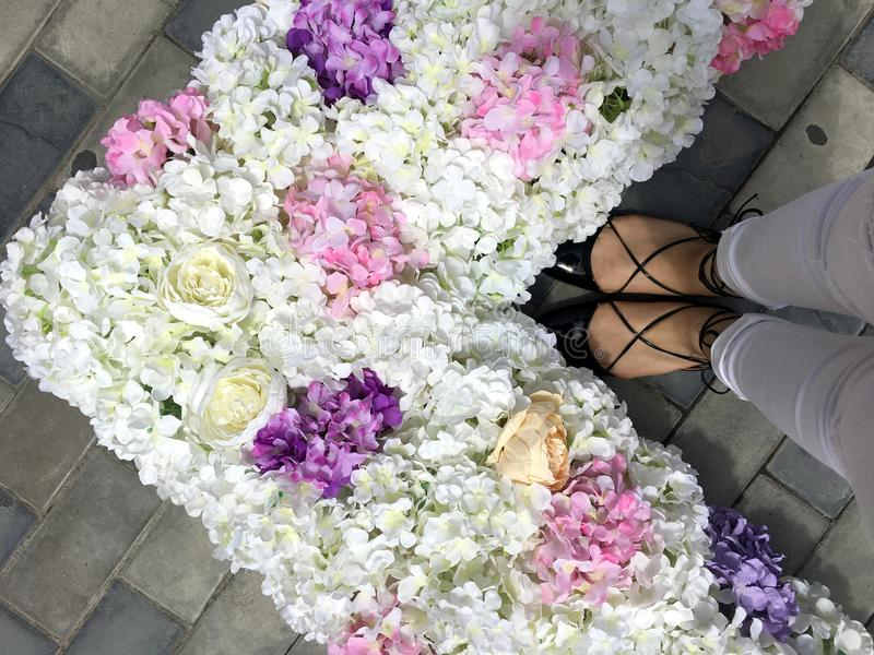 Woman feet, flowers and love royalty free stock photos