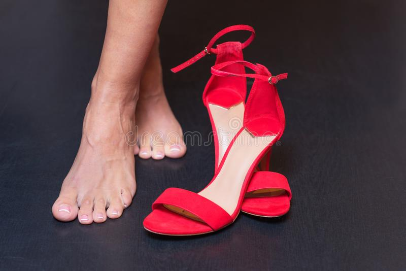 Woman feet and red sandals.  stock images