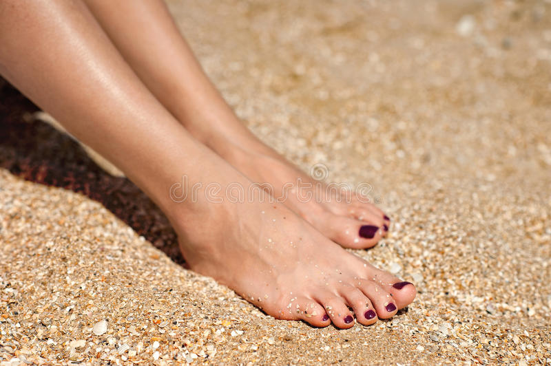 Woman feet on sand royalty free stock images
