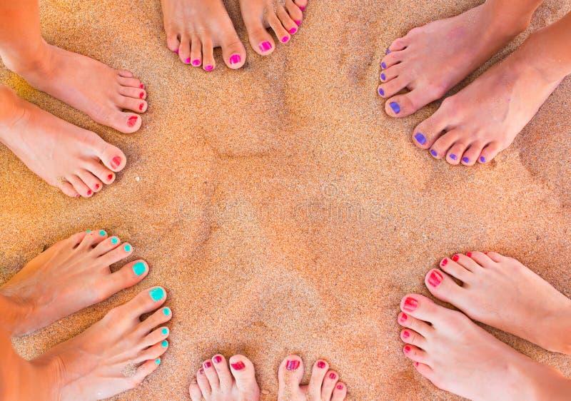 Woman feet on the sand royalty free stock photos