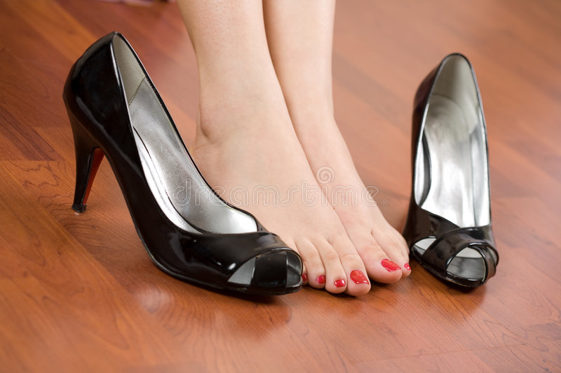Woman feet and shoes. Woman feet with shoes nearby royalty free stock images