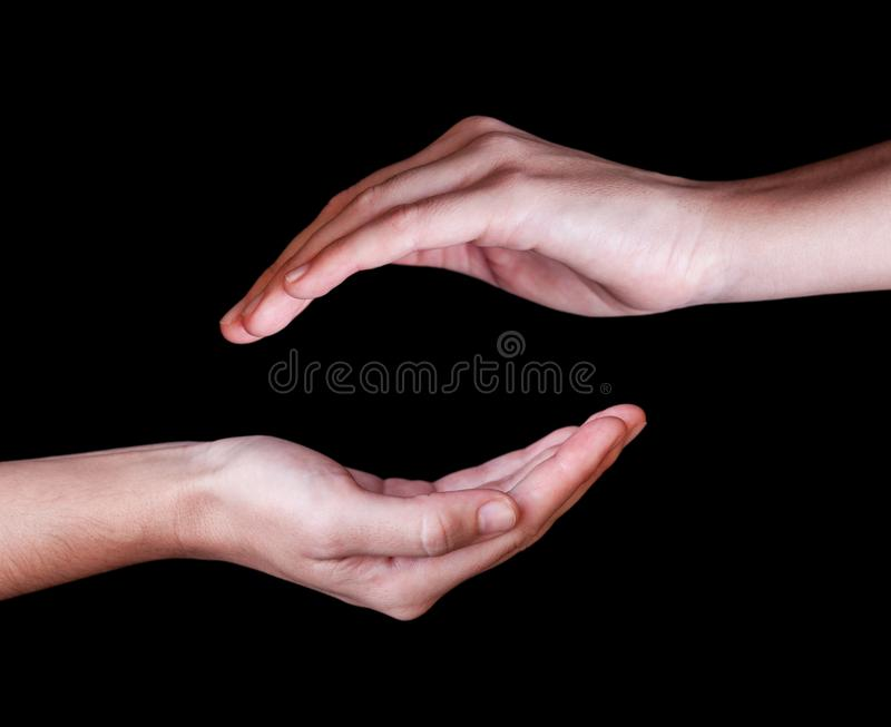 Woman or female hands cupped in a protection, protection, safety or safe concept symbol royalty free stock images