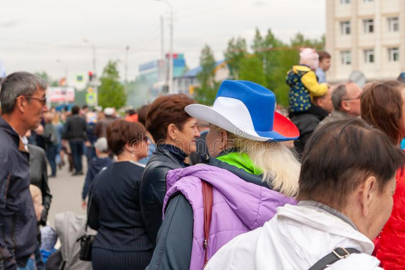 A woman at the festival in a cowboy hat, painted in the tricolour of the Russian flag stock image