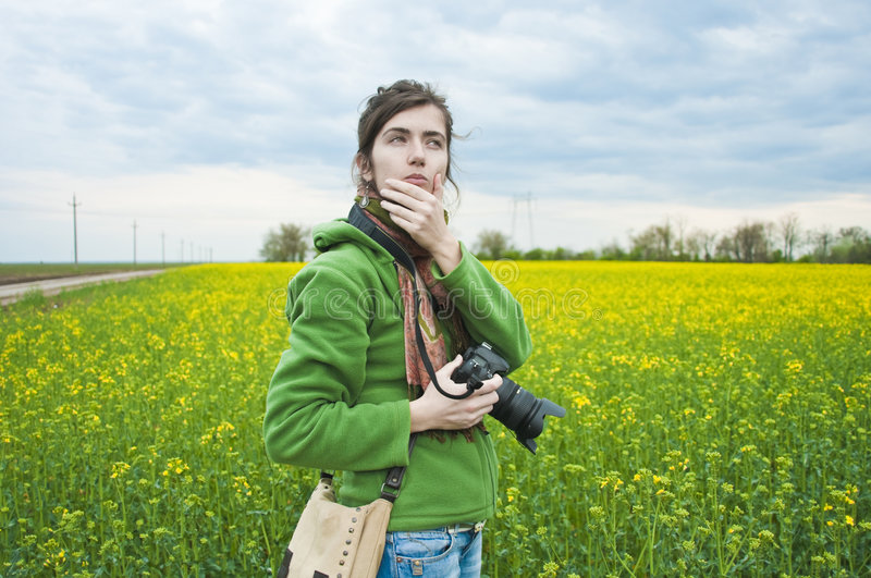 Download Woman in field with camera stock image. Image of field - 9221661