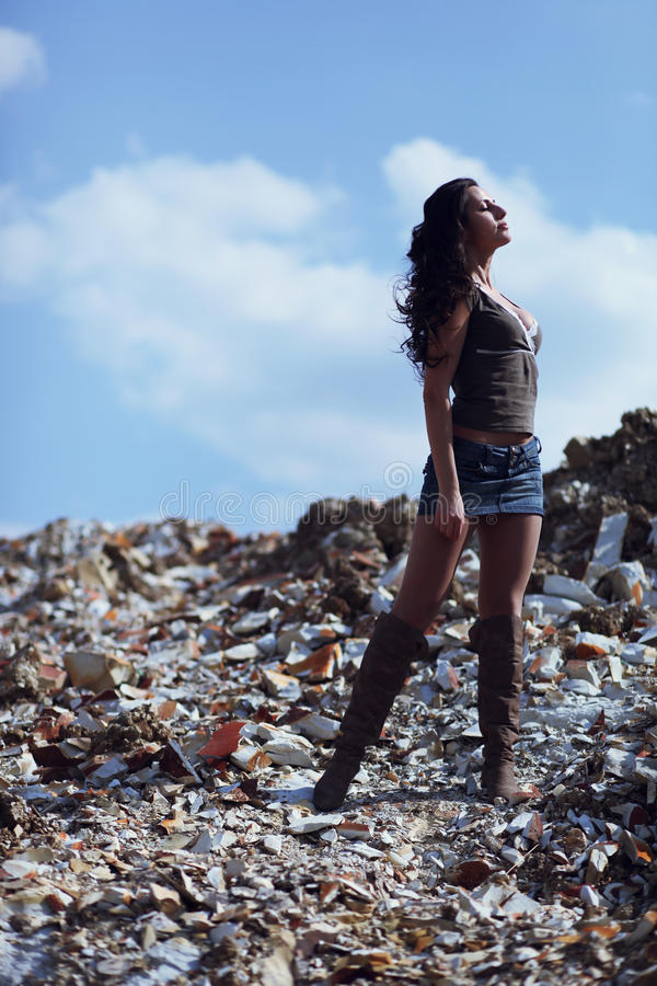 Woman in field of crumbled rocks royalty free stock images