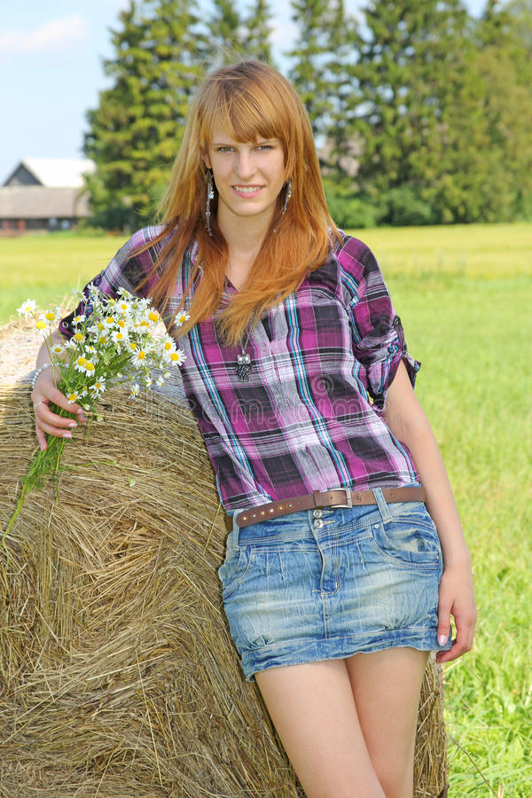 Download Woman In A Field With Hay Bales Stock Photo - Image: 26243098