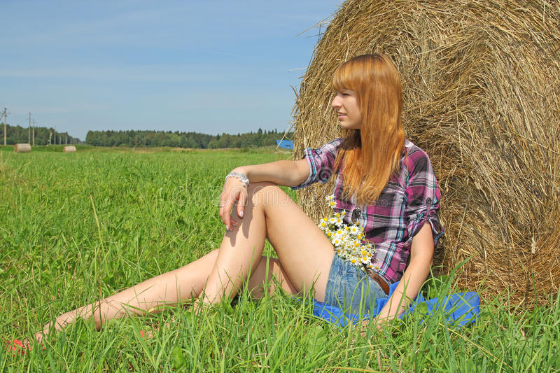 Woman In A Field With Hay Bales Royalty Free Stock Images