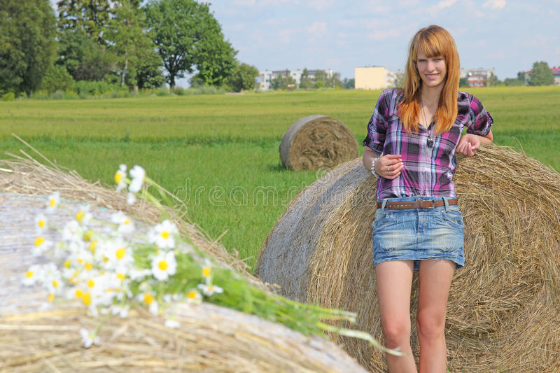 Download Woman In A Field With Hay Bales Stock Image - Image: 26243129