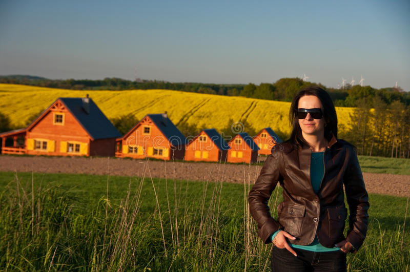 Woman in field by houses royalty free stock photos