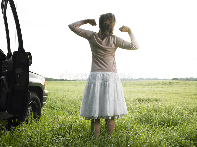 Download Woman in Field Stretching stock photo. Image of adult - 12602936
