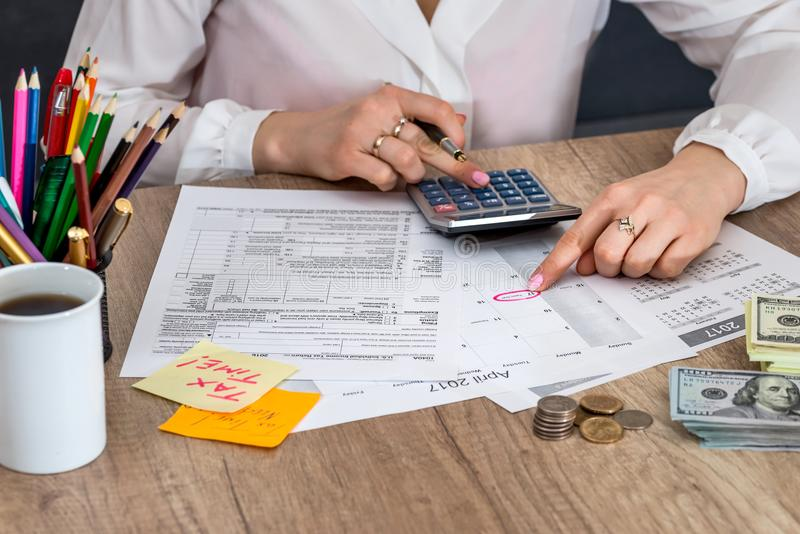 Woman filing US tax form. Annual budget royalty free stock images